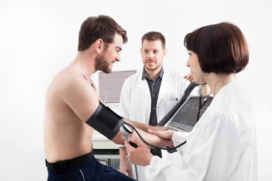 Cardiovascular Technologist Helps Administer a Stress Test